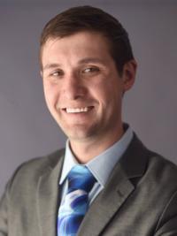 B. Dustin Pooler, M.D.